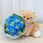 Teddy and blue roses