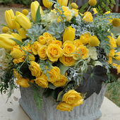 Bunch of yellow roses and tulips