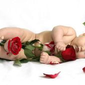 Adorable Baby and Beautiful Roses