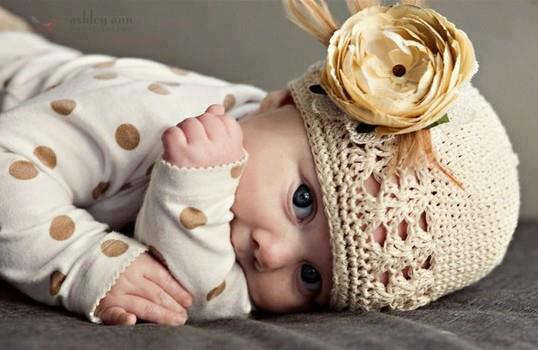 Beautiful baby with rose