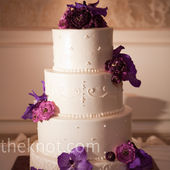 Love the exotic purple flowers and the small detail in the icing