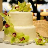 White cake with green orchids