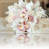 White orchid bouquet with ostrich feathers