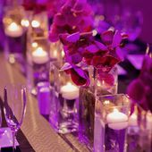Orchids and purple uplighting