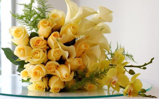 Yellow roses, orchids and calla lilies