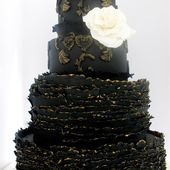 Black cake with white rose