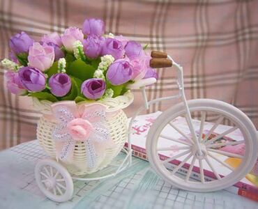 Purple tulips in tricycle vase