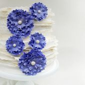 White Frills Cake with Large Purple Flowers