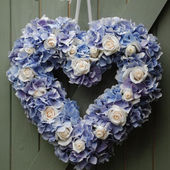 Blue hydrangea white roses heart wreath