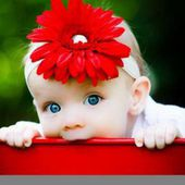 Baby and red flower