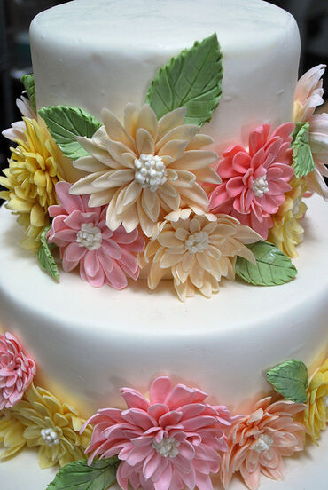 Dahlia covered tiered wedding cake